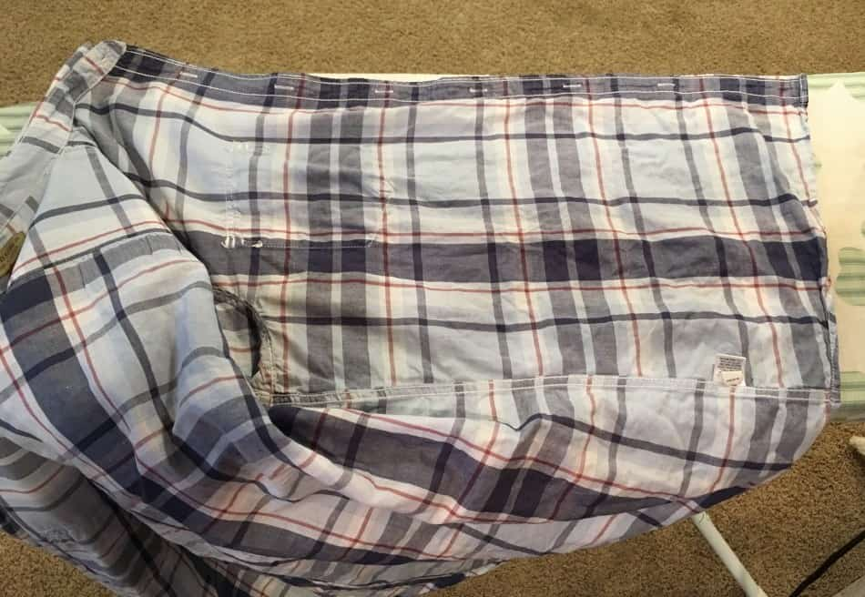 Blue plaid shirt on ironing board