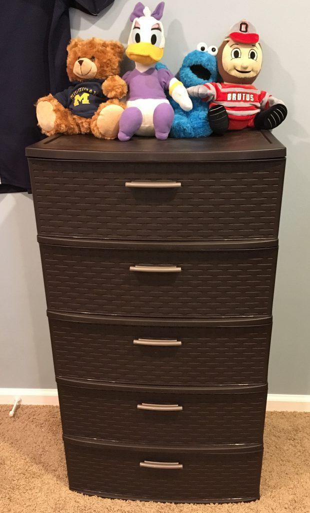 Brown wicker-looking plastic drawers. 5 drawers with stuffed animals on top