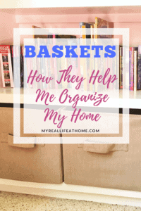 Title Baskets How They Help me Organize My Home with books on a shelf and fabric baskets in the background
