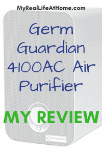 GermGuardian AC 4100 air purifier sitting on brown wood night stand