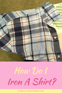 Blue plaid shirt and sleeve on an ironing board