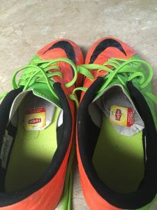 Soccer cleats with Lipton tea bags inside sitting on a counter