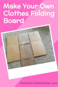cardboard clothes folding board on carpet