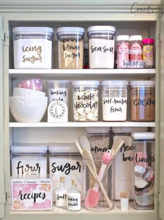 clear containers in pantry with labels