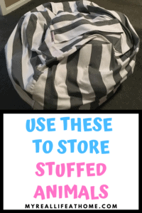 gray and white striped toy storage bag, similar to bean bag chair