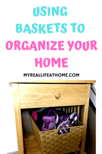 woven baskets with children shoes inside sitting on a wood end table lower shelf