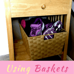 Wood Side table with a basket full of shoes on bottom shelf