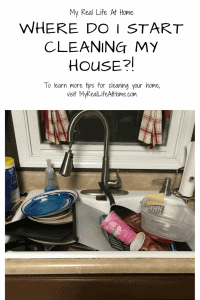 white kitchen sink full of dirty dishes