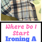 Blue plaid shirt and sleeve on the end of an ironing board