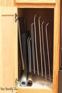 baking sheets stored vertically in cabinet