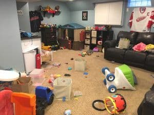 basement with a mess of toys all over the floor
