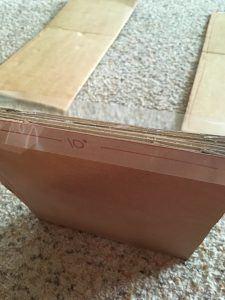 cardboard clothes folder folded up