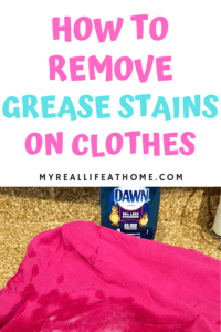 Pink Shirt with grease stain and Dawn bottle on granite counter