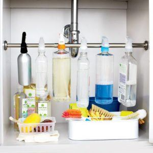 tension rod under the sink holding spray bottles